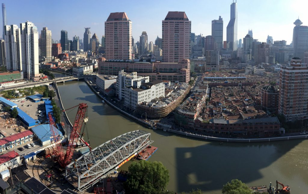- shangai skyline 1024x647 - Curbs on investment and speculation cools China's tier 1 property prices: Moody's Report