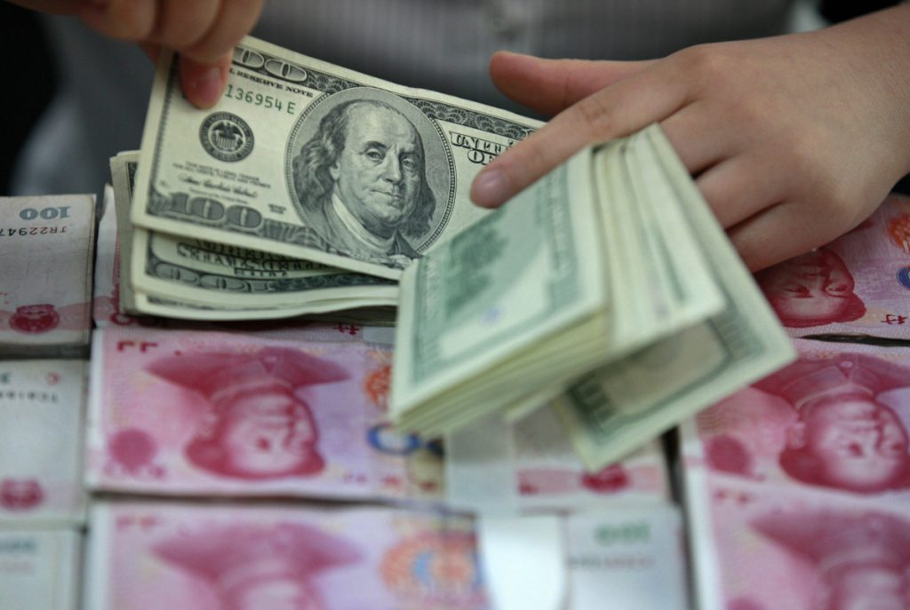 - us dollar chinese yuan bank notes 1024x687 - China denies currency manipulation allegations ahead of Xi-Trump meeting