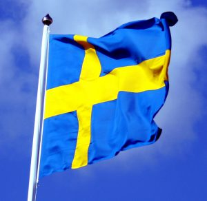 traders news - swedish sweden flag with blue sky behind ausschnitt 300x292 - Home