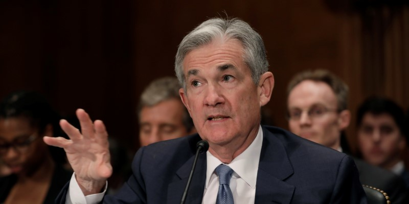 Fed stays put, keeps target range for Fed funds at 2.0%-2.25%